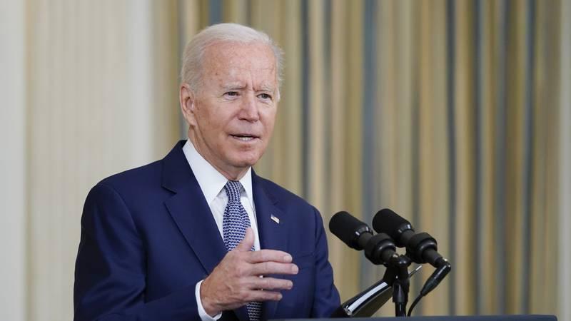 President Joe Biden speaks from the State Dining Room of the White House in Washington, Friday,...
