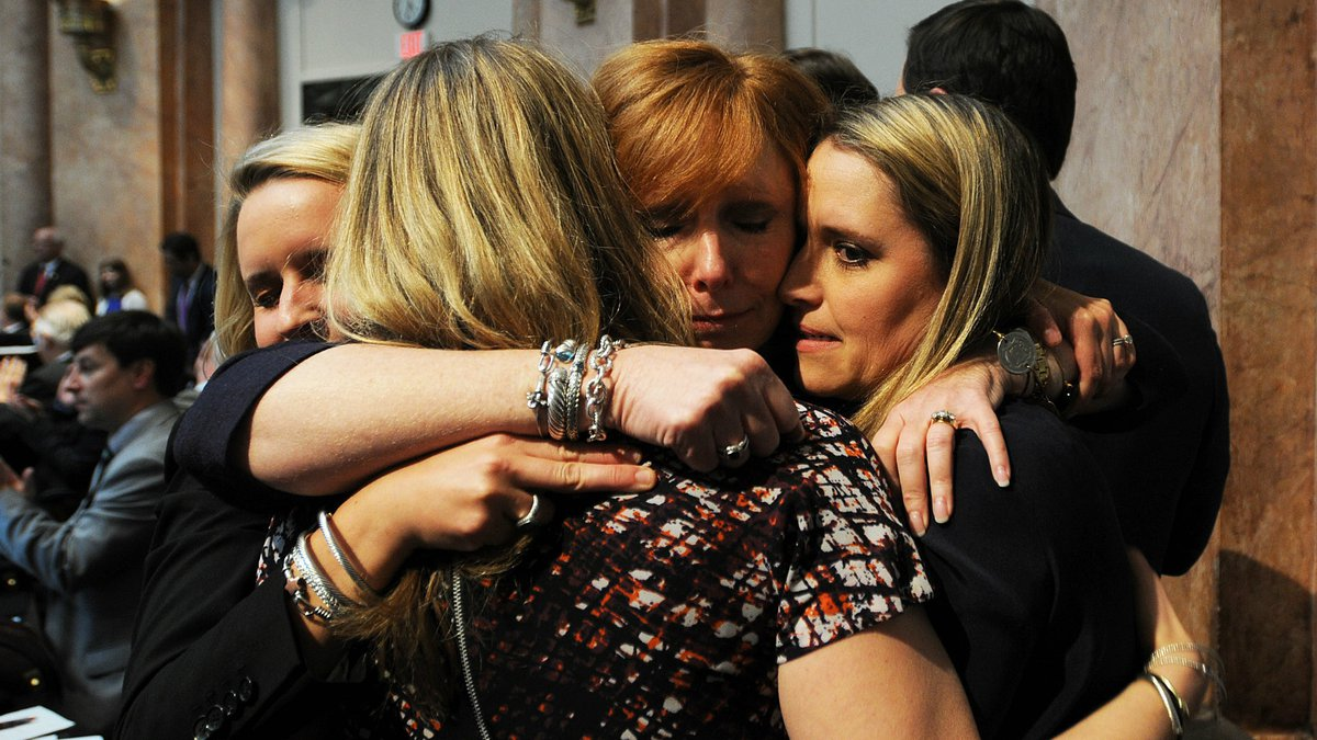 The family of Mark Hinkel hugged after lawmakers passed a bill toughening Kentucky's DUI laws.