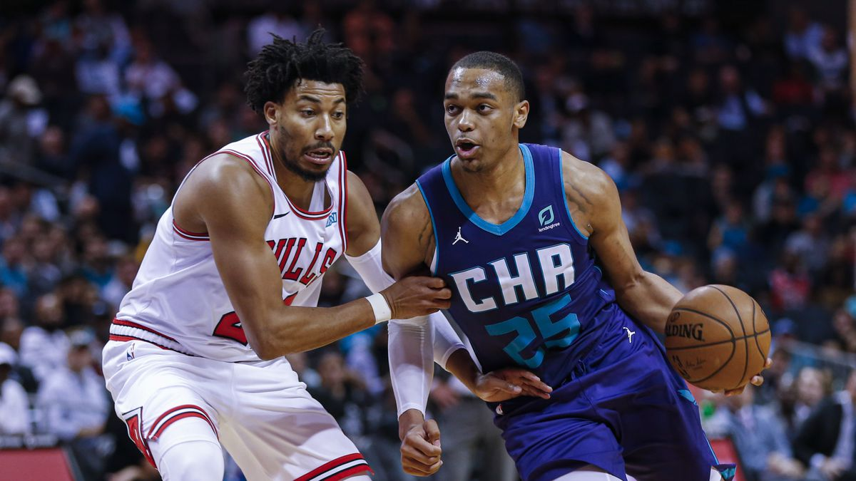 Charlotte Hornets forward PJ Washington, right, drives to the basket against Chicago Bulls forward Otto Porter Jr. during the second half of an NBA basketball game in Charlotte, N.C., Wednesday, Oct. 23, 2019. (AP Photo/Nell Redmond)
