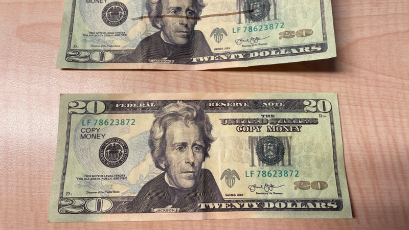 """This is what the counterfeit money looks like with the words """"Copy Me"""" written across the bill."""