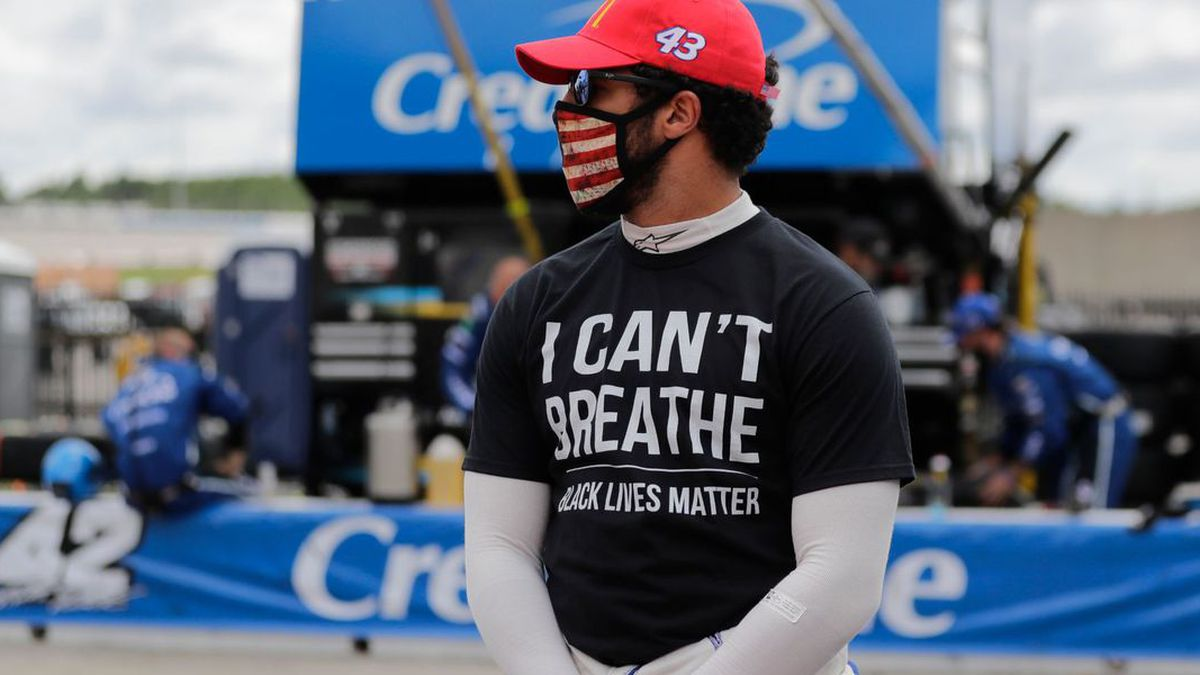 "Bubba Wallace (43) wears a ""I Can't Breath, Black Lives Matter"" shirt before a NASCAR Cup Series auto race at Atlanta Motor Speedway, Sunday, June 7, 2020, in Hampton, Ga."