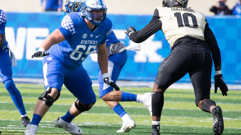Kentucky Wildcats offensive tackle Landon Young , normally, (67) wore a #65 to  honor assistant...