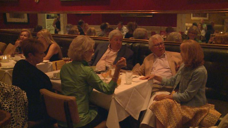 Dudley's on Short owner Debbie Long celebrates the restaurant's 40th anniversary with friends.