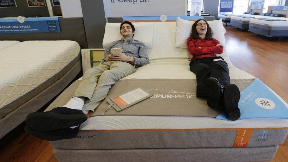 Preston Soper, left and Jacquine Vehmeier tried out a Tempur-Pedic mattress as part of their...